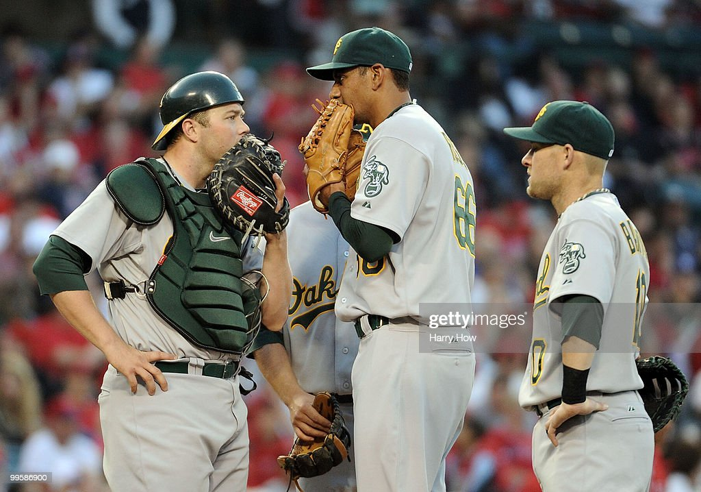 Tyson Ross #66, Landon Powell #35 and Daric Barton #10 of the Oakland Athletics meet at the mound in the game against the Los Angeles Angels during the fourth inning at Angels Stadium on May 15, 2010 in Anaheim, California.