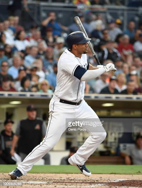 Tyson Ross of the San Diego Padres hits an RBI single during the fourth inning of a baseball game against the Arizona Diamondbacks PETCO Park on July...