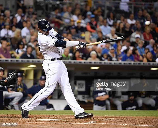 Tyson Ross of the San Diego Padres hits an RBI single during the fourth inning of a baseball game against the Milwaukee Brewers at Petco Park...