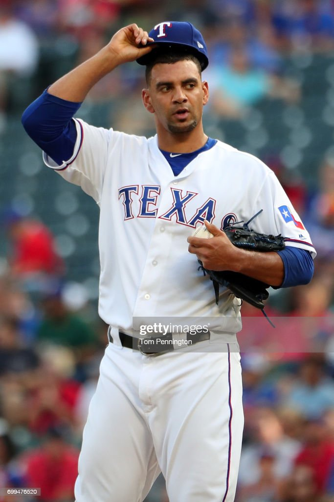 Tyson Ross #44 of the Texas Rangers reacts after giving up a run against the Toronto Blue Jays in the top of the first inning at Globe Life Park in Arlington on June 21, 2017 in Arlington, Texas.
