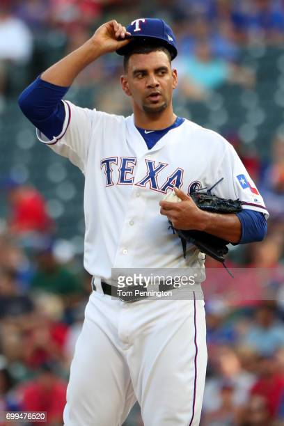 Tyson Ross of the Texas Rangers reacts after giving up a run against the Toronto Blue Jays in the top of the first inning at Globe Life Park in...