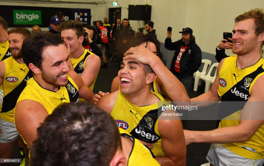 Tyson Stengle of the Tigers sings the club song with his team mates after defeating the Power during the round 15 AFL match between the Port Adelaide Power and the Richmond Tigers at Adelaide Oval on July 1, 2017 in Adelaide, Australia.