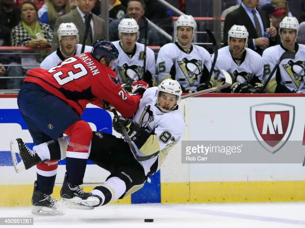 Tyson Strachan of the Washington Capitals checks Sidney Crosby of the Pittsburgh Penguins during the second period at Verizon Center on November 20...