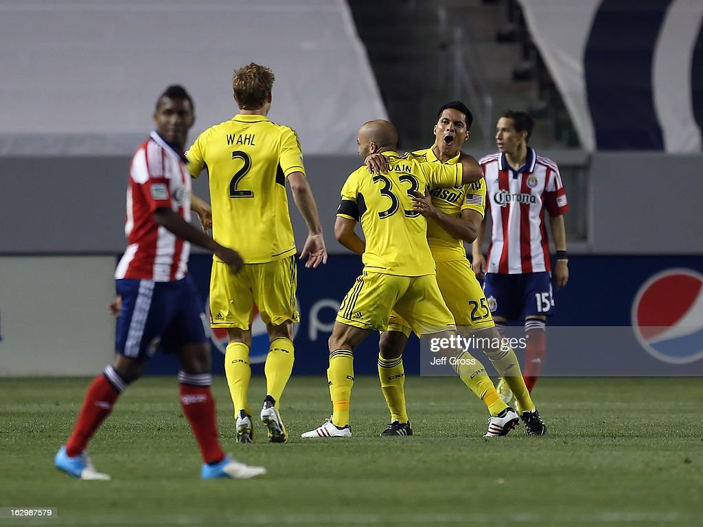 Tyson Wahl #2, Federico Higuain #33 and Jairo Arrieta #25 of the Columbus Crew celebrate Higuain's goal in the second half against Chivas USA at The Home Depot Center on March 2, 2013 in Carson, California. The Crew defeated Chivas USA