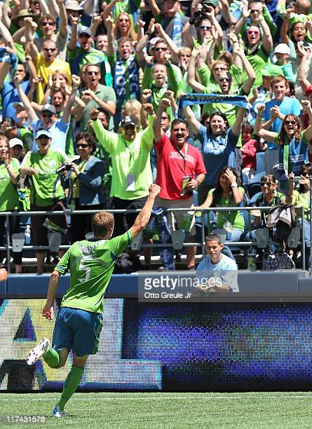 Tyson Wahl of the Seattle Sounders FC celebrates after scoring a goal against the New England Revolution at CenturyLink Field on June 26 2011 in...