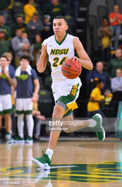 Tyson Ward of the North Dakota State Bison brings the ball up the court against the Omaha Mavericks during their game at Scheels Center on February...