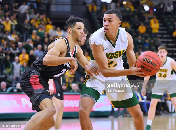 Tyson Ward of the North Dakota State Bison looks to drive against Zach Jackson of the Omaha Mavericks during their game at Scheels Center on February...
