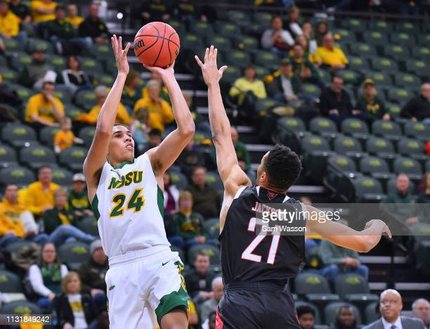 Tyson Ward of the North Dakota State Bison shoots against Zach Jackson of the Omaha Mavericks during their game at Scheels Center on February 23 2019...