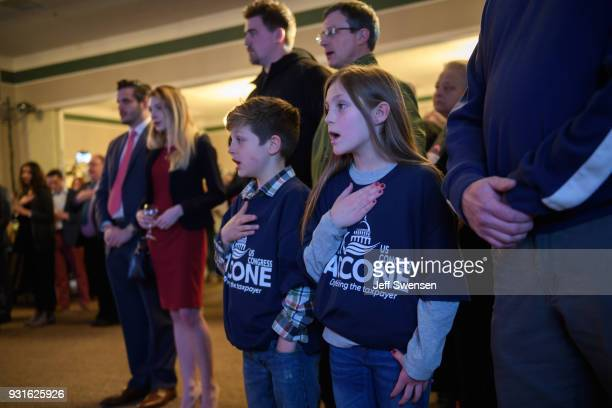 Tyten Springer and his sister Lowen sing the National Anthem at an Election Night event for GOP PA Congressional Candidate Rick Saccone as the polls...