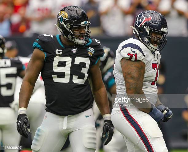 Tytus Howard of the Houston Texans and Calais Campbell of the Jacksonville Jaguars exchange words during the second half at NRG Stadium on September...