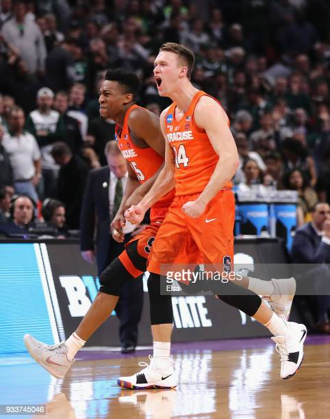Tyus Battle of the Syracuse Orange and Braedon Bayer celebrate after defeating the Michigan State Spartans 5553 in the second round of the 2018 NCAA...