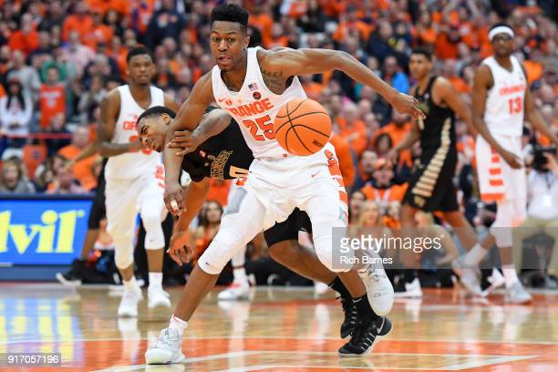 Tyus Battle of the Syracuse Orange and Brandon Childress of the Wake Forest Demon Deacons battle for control of the ball during the second half at...