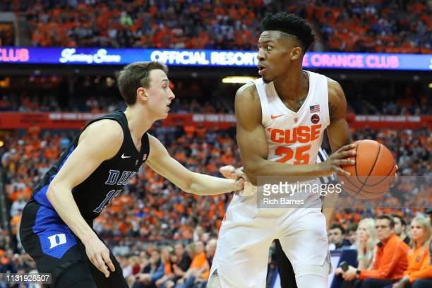 Tyus Battle of the Syracuse Orange controls the ball as Alex O'Connell of the Duke Blue Devils defends during the second half at the Carrier Dome on...