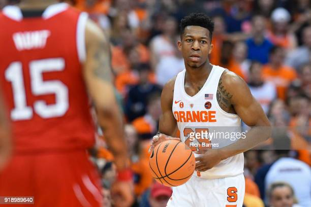 Tyus Battle of the Syracuse Orange controls the ball as Sam Hunt of the North Carolina State Wolfpack defends during the first half at the Carrier...