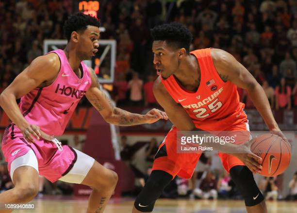 Tyus Battle of the Syracuse Orange dribbles while being guarded by Nickeil AlexanderWalker of the Virginia Tech Hokies at Cassell Coliseum on January...