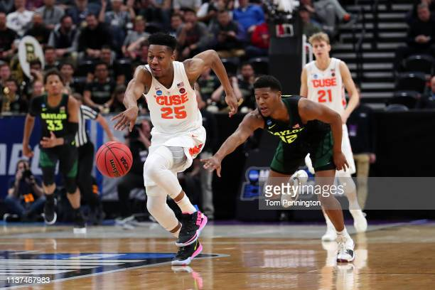 Tyus Battle of the Syracuse Orange drives against Jared Butler of the Baylor Bears during the second half in the first round of the 2019 NCAA Men's...