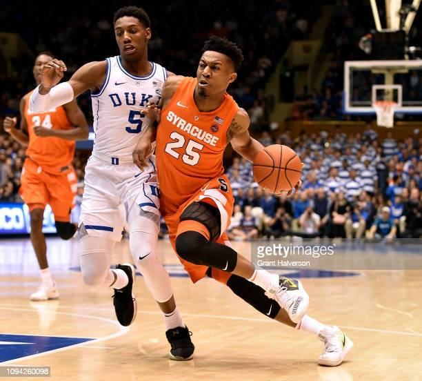 Tyus Battle of the Syracuse Orange drives against RJ Barrett of the Duke Blue Devils during the first half of their game at Cameron Indoor Stadium on...