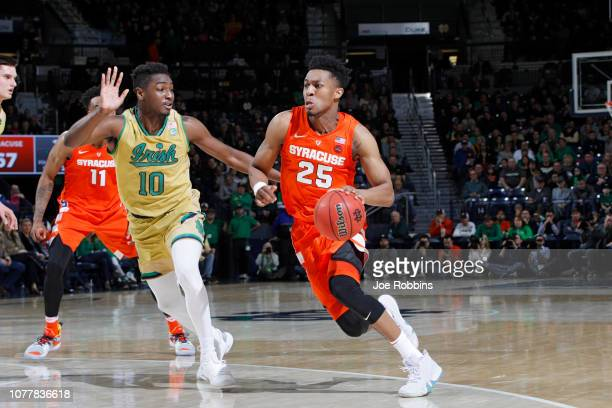 Tyus Battle of the Syracuse Orange drives against TJ Gibbs of the Notre Dame Fighting Irish in the second half of the game at Purcell Pavilion on...