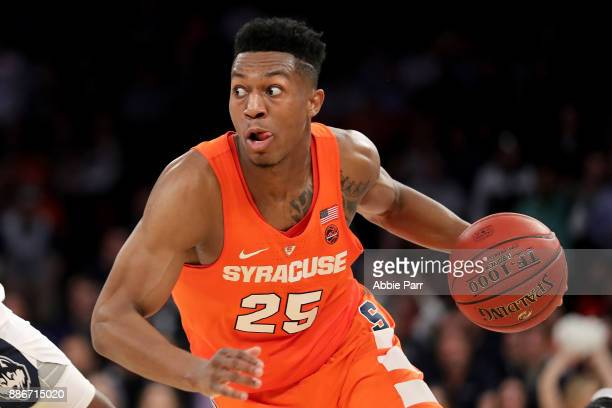 Tyus Battle of the Syracuse Orange drives down the court in the second half against the Connecticut Huskies during their game at Madison Square...