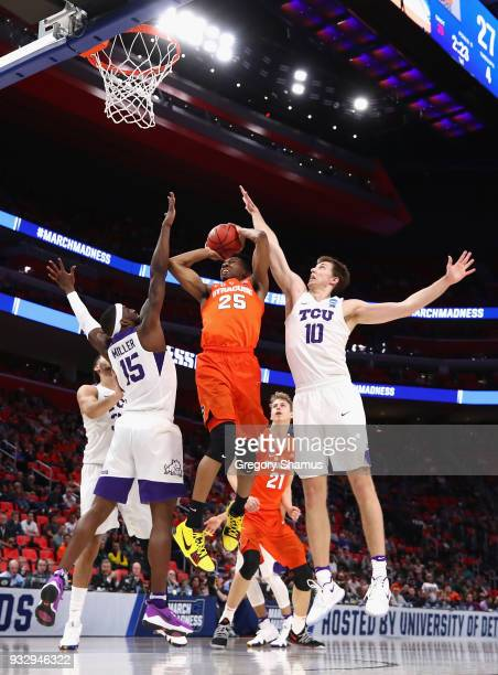 Tyus Battle of the Syracuse Orange drives to the basket against JD Miller and Vladimir Brodziansky of the TCU Horned Frogs during the first half in...