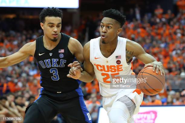 Tyus Battle of the Syracuse Orange drives to the basket against the defense of Tre Jones of the Duke Blue Devils during the second half at the...