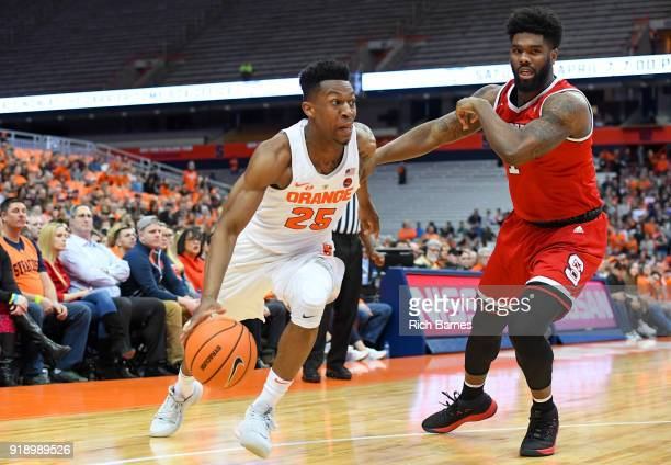 Tyus Battle of the Syracuse Orange drives to the basket against the defense of Lennard Freeman of the North Carolina State Wolfpack during the first...