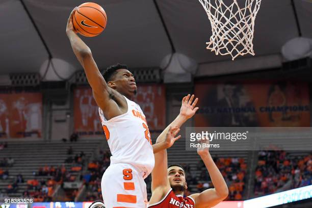 Tyus Battle of the Syracuse Orange drives to the basket for a dunk over Omer Yurtseven of the North Carolina State Wolfpack during the first half at...