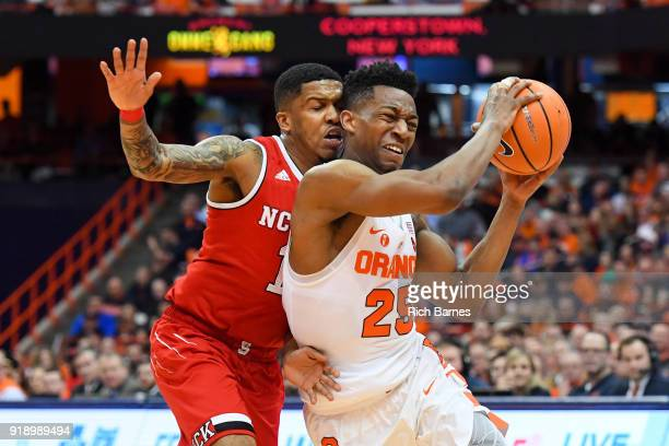Tyus Battle of the Syracuse Orange drives to the basket past Sam Hunt of the North Carolina State Wolfpack during the first half at the Carrier Dome...