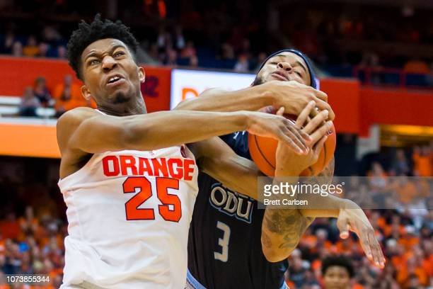 Tyus Battle of the Syracuse Orange fouls BJ Stith of the Old Dominion Monarchs as they battle for a loose ball during the second half at the Carrier...