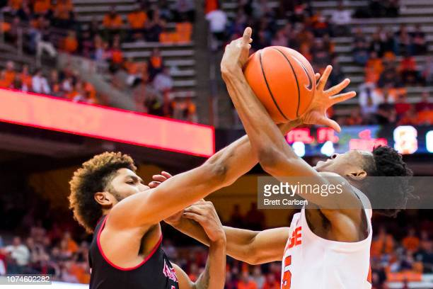 Tyus Battle of the Syracuse Orange is fouled as he drives to the basket by Tristin Walley of the Arkansas State Red Wolves during the second half at...