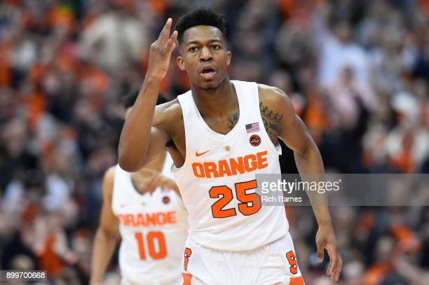 Tyus Battle of the Syracuse Orange reacts to a threepoint basket against the Eastern Michigan Eagles during the first half at the Carrier Dome on...