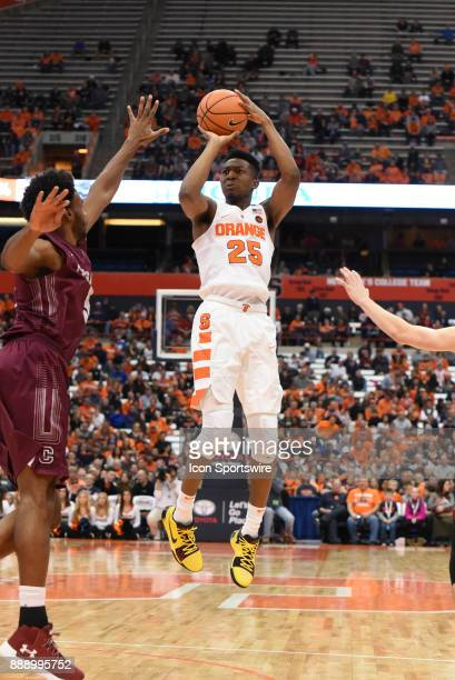Tyus Battle of the Syracuse Orange shoots a 3 point shot during the second half of play between the Syracuse Orange and the Colgate Raiders on...