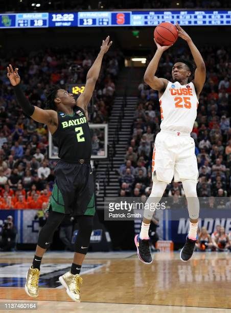 Tyus Battle of the Syracuse Orange shoots against Devonte Bandoo of the Baylor Bears during the first half in the first round of the 2019 NCAA Men's...