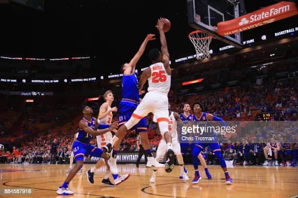 Tyus Battle of the Syracuse Orange shoots as Elijah Hughes of the Devonte' Graham of the Kansas Jayhawks looks on during the HoopHall Miami...