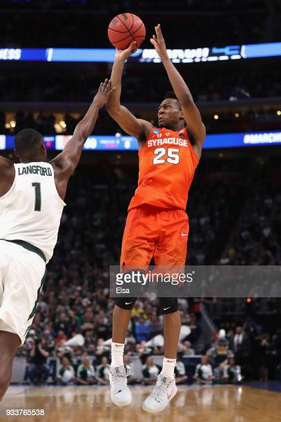 Tyus Battle of the Syracuse Orange shoots the ball against Joshua Langford of the Michigan State Spartans during the second half in the second round...