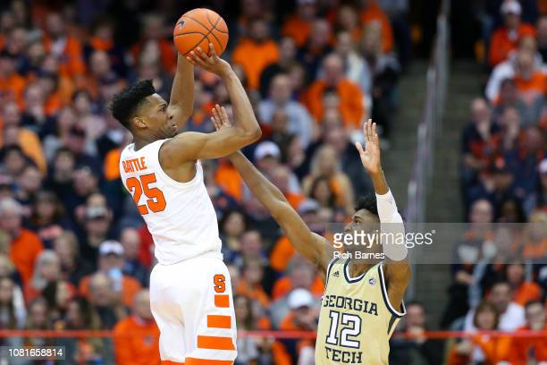 Tyus Battle of the Syracuse Orange shoots the ball against the defense of Khalid Moore of the Georgia Tech Yellow Jackets during the first half at...