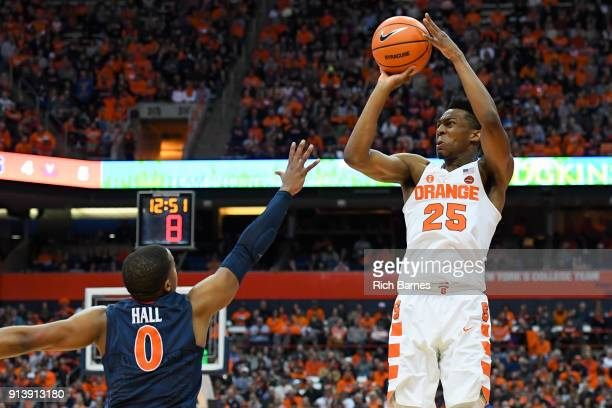 Tyus Battle of the Syracuse Orange shoots the ball against the defense of Devon Hall of the Virginia Cavaliers during the second half at the Carrier...