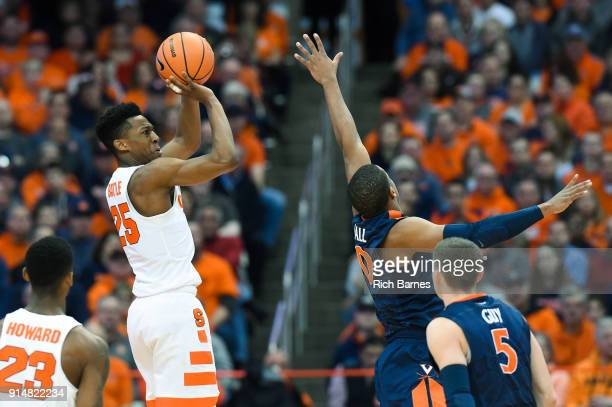 Tyus Battle of the Syracuse Orange shoots the ball against the defense of Devon Hall of the Virginia Cavaliers during the first half at the Carrier...