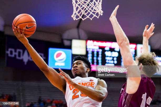Tyus Battle of the Syracuse Orange shoots the ball during the second half against Dana Batt of the Colgate Raiders at the Carrier Dome on November 21...