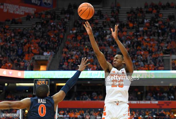 Tyus Battle of the Syracuse Orange shoots the ball over Devon Hall of the Virginia Cavaliers during the second half at the Carrier Dome on February 3...