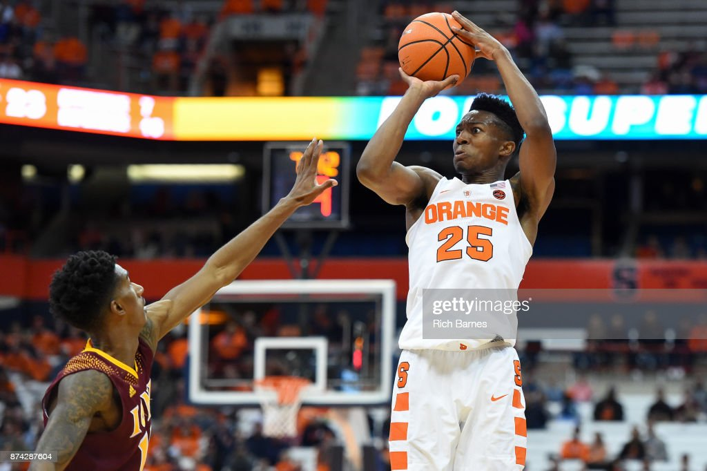 Tyus Battle #25 of the Syracuse Orange shoots the ball over Deyshonee Much #15 of the Iona Gaels during the second half at the Carrier Dome on November 14, 2017 in Syracuse, New York. Syracuse defeated Iona 71-62.