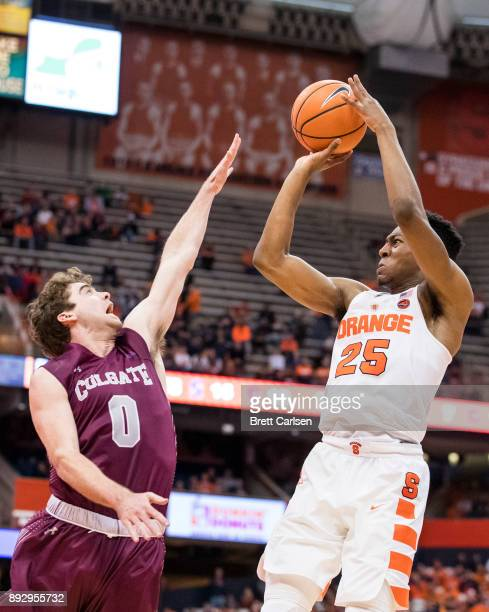 Tyus Battle of the Syracuse Orange shoots the ball over the hands of Sean O'Brien of the Colgate Raiders during the second half at the Carrier Dome...