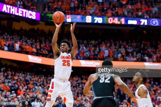 Tyus Battle of the Syracuse Orange shoots the game winning basket in the final seconds against the Georgetown Hoyas at the Carrier Dome on December 8...