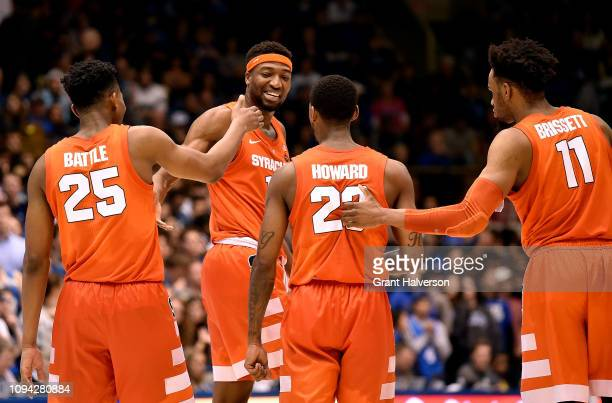 Tyus Battle Paschal Chukwu Frank Howard and Oshae Brissett of the Syracuse Orange celebrate during the final seconds of a win against the Syracuse...