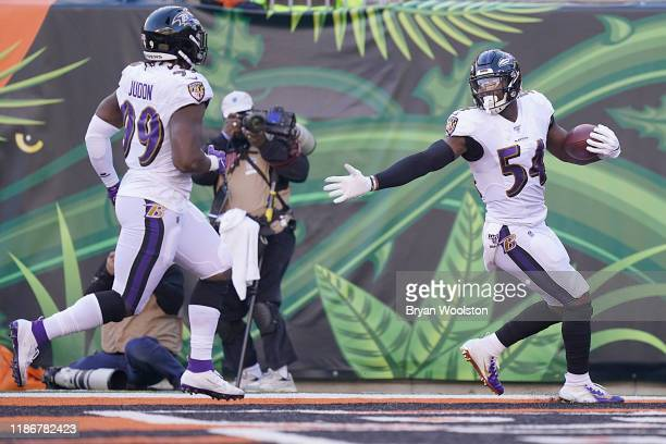 Tyus Bowser of the Baltimore Ravens celebrates after scoring a touchdown during the NFL football game against the Cincinnati Bengals at Paul Brown...