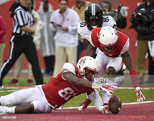 Tyus Bowser the Houston Cougars recovers a Cincinnati Bearcats' fumble in the second quarter of a NCAA football game at TDECU Stadium on November 7...