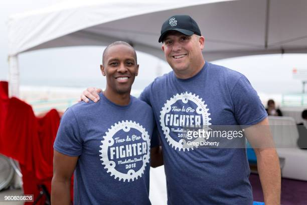 Tyus Edney and Clay Helton attends the 6th Annual Tour de Pier at Manhattan Beach Pier on May 20 2018 in Manhattan Beach California