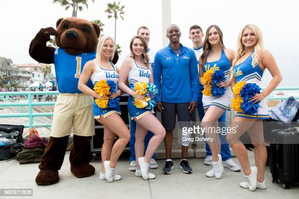 Tyus Edney poses for a picture with the UCLA Cheer Squad at the 6th Annual Tour de Pier at Manhattan Beach Pier on May 20 2018 in Manhattan Beach...