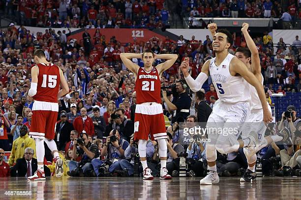 Tyus Jones and Grayson Allen of the Duke Blue Devils celebrate after defeating the Wisconsin Badgers as Sam Dekker and Josh Gasser look on during the...