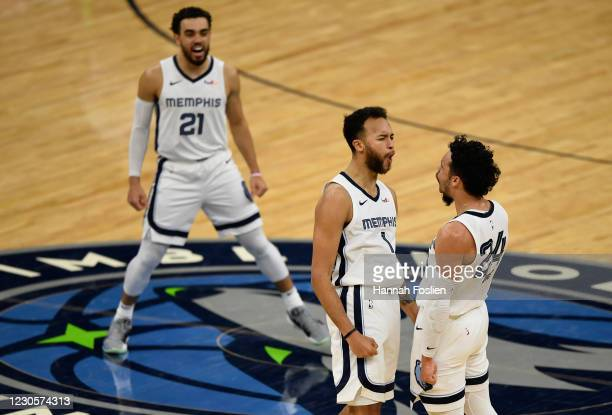 Tyus Jones, Kyle Anderson and Dillon Brooks of the Memphis Grizzlies celebrate during the fourth quarter of the game against the Minnesota...